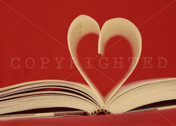 heart shaped pages in book with red background print