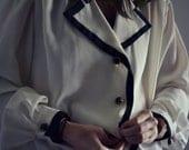 Cream and black dressy top