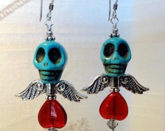 Dia de los Muertos Earrings - Turquoise winged skull w/ red heart