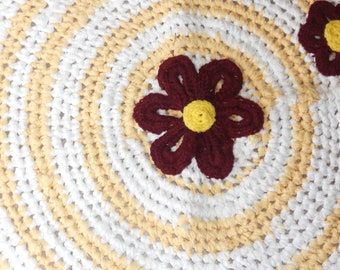 Circle Sunshine and Gerber daisies. Crocheted rag rug.