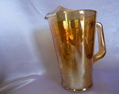 Exclusive for Nancy, Marigold Carnival glass pitcher with lovely diagonal swirls