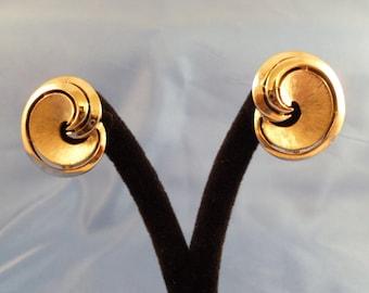Trifari Silver swirl Clip earrings.