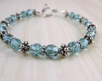 Sea green Czech glass beads and Bali bead bracelet