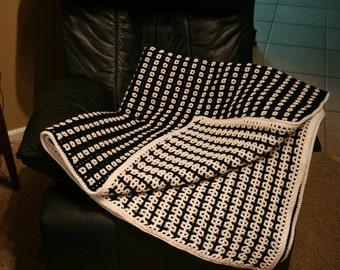 Black and white reversible crochet afghan