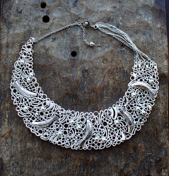 Silver Plated Lacy and Summery Bib Necklace Dancing fish. Example
