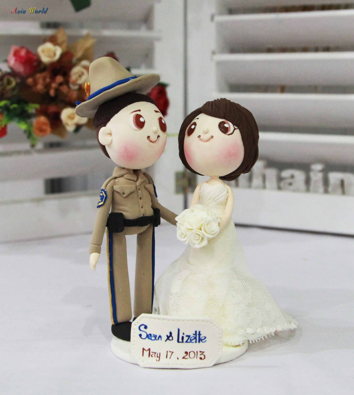 Wedding cake topper CHP ficer groom and beautiful bride clay