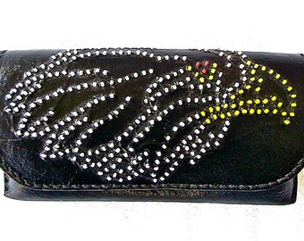 Black leather eyeglass case with beaded eagle design.