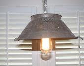 Vintage colander hanging swag lamp.