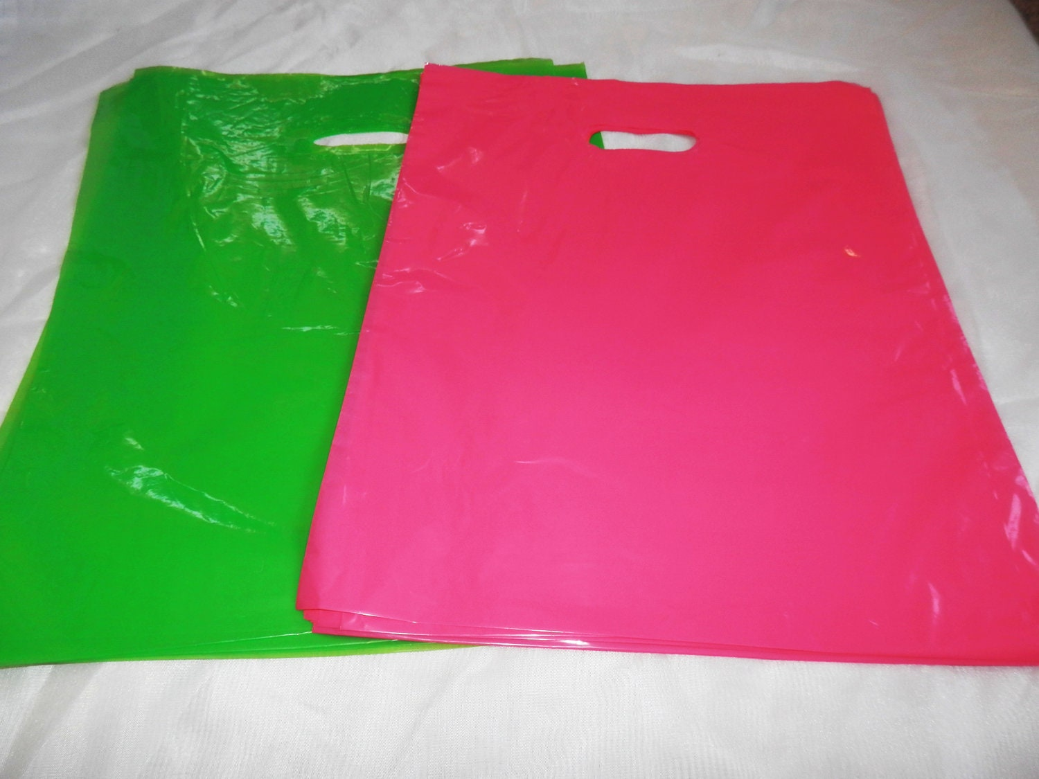 100 12x15 glossy lime green and pink plastic merchandise for 12x15 calculator