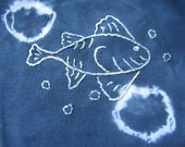 Now 50% off-Hand Tie Dyed and embroidered onesie featuring a fish design with bubbles set against a navy blue background