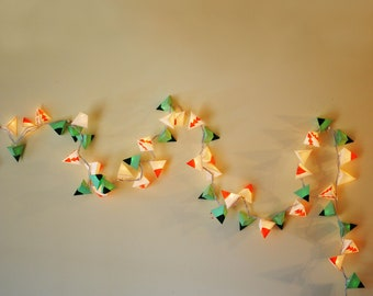 Christmas Light Garland - GAIA'S KITCHEN - handmade paper lanterns in green, speckled white, and coral, with stacked coral triangles