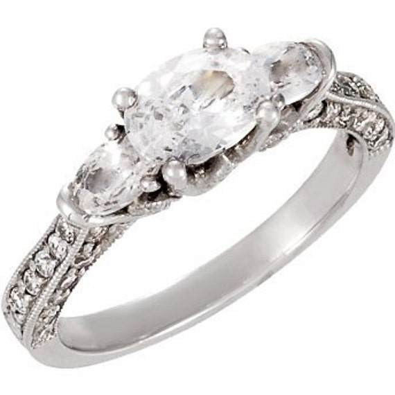 Oval Three Stone Engagement Ring 0.25pt for 1.00ct center 14kt White Gold