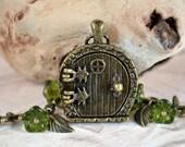 Fairy Door Locket, Garden Door Necklace, Bronze Leaves, Mossy Green Glass Flower Necklace