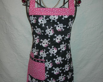 Reversible Apron in Sparkly Skulls with Sassy Pink Bows, and Pink Polka Dots. Hot and Sweet for those wild nights in the kitchen...