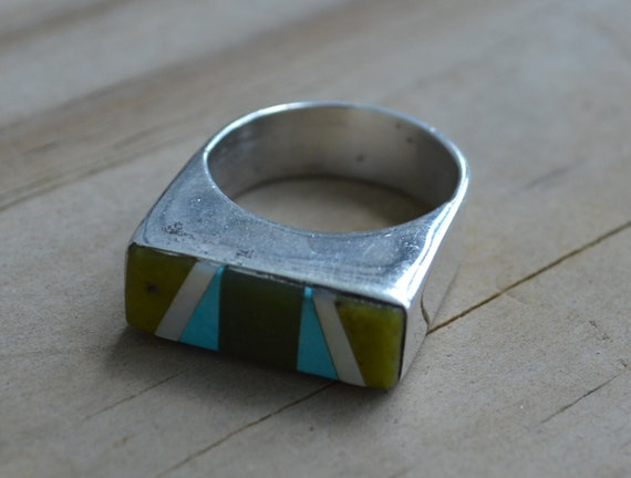 HOLDAmazing Native american indian Zuni handmade southwest coin silver ring signed by artist T. Leonard with turquoise and mother of pearl