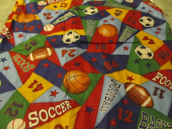 Multicolored sports fabric, bright primary colors, balls, sports , fabric for small projects.