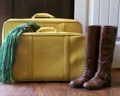 Vintage Canary Yellow set of luggage.