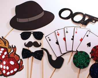 James Bond Themed Photo Booth Props - Features oversized deck of cards, glittered dice on fire, and more...