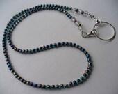 Blue and Black Aurora Borealis Color Beaded Necklace   Eyeglass Holder