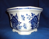 a vintage blue and white planter from the presidentspalace