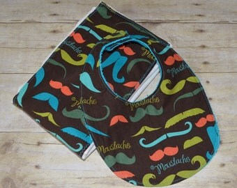 Two Piece Mustache All Over Bib and Burp Pad Set