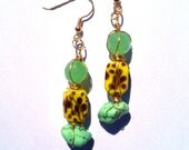 Jade bead, yellow printed bead, and jade stone wrapped in gold wire