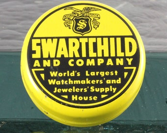 Yellow and Black Vintage Swartchild and Company Watchmaker's Tin