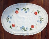 Vintage EMBROIDERED Flowers on a piece of linen with LACE border, White oval, center piece.
