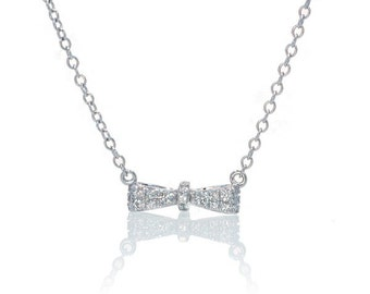 18 Karat White Gold Diamond Mini Bow Bar Pendant Necklace