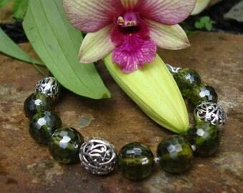 Faceted olive green 12mm quartz and sterling silver bracelet.