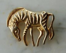 """Vintage goldtone Zebra pin. nice detail . excellent condition 1 1/2"""" long X 1 1/4"""" tall. 1980's"""