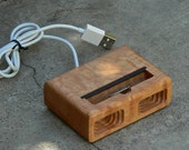 Acoustic dock  for iPhone 4 in Curly Maple- Amplifies sound through unique acoustical pockets .