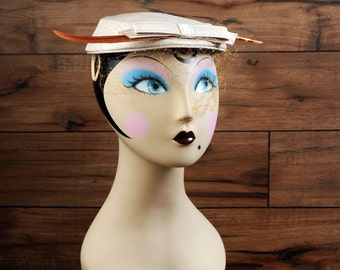 Vintage hat with bow, veil and feather on front