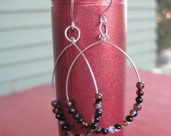 Earthy multi-colored Botswana agate ovular earrings on silver wires.