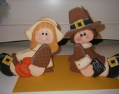 Pilgrim shelf sitters with pumpkin for Thanksgiving