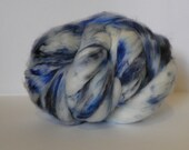 Hand dyed Super washed Merino Roving.  Colorway name is Coastal Openings .