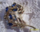 Vintage Crystal Brooch-Blue and Clear Crystal Flowers with Gold Tone Metal Stems