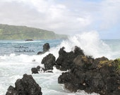 Hawaii, Coastline of Maui showing the amazing black vocanic rock with the swirling ocean.