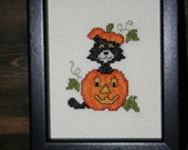Cross Stitched Halloween Cat and Pumpkin Picture.