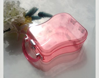 Rare deadstock pear shape vintage looking Perspex clutch box with handle