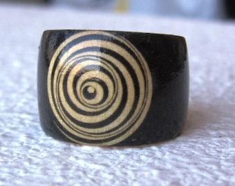 Marcel Duchamp Optical Disk -- wood finger ring