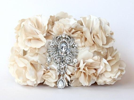 Ivory satin bridal clutch adorned with a stunning Swarovski crystal encrusted brooch.