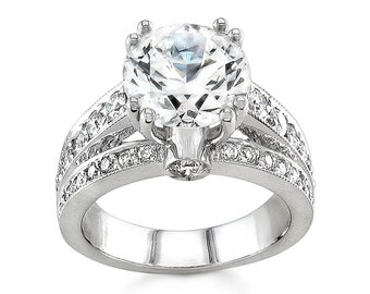 Ladies 14kt white gold engagement ring with 0.80 ctw G-VS2 diamonds and 2ct natural Round White Sapphire center
