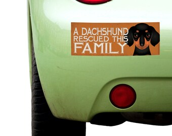"""Dogs Incorporated Sticker - A Dachshund Rescued This Family  -  Rescue Dog Bumper Sticker 3""""x 8"""" Coated Vinyl"""