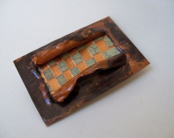 Copper brooch woven with sheet metal, copper foil, and paper