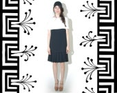 The Cutest Black and White Crepe Drop Waist Dress