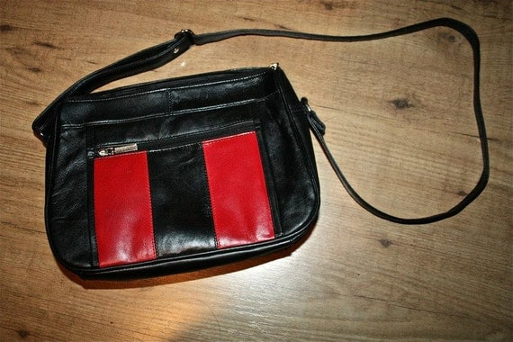 Vintage black and red leather cross body purse.