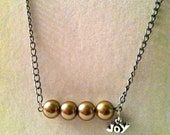"""Pearl Beaded Inspirational silver chain Necklace in a gold color with pewter """"Joy"""" charm attached"""
