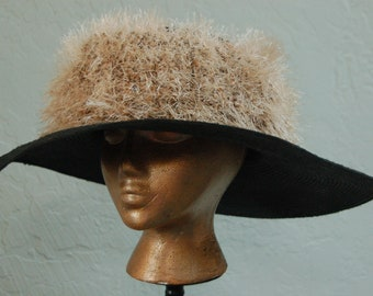 Black wide brimmer straw Derby hat with textured crown.
