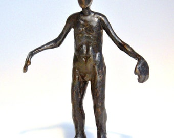 Bronze sculpture walking male figure
